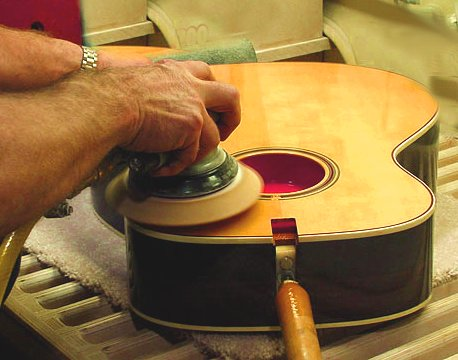 hand sander on guitar top